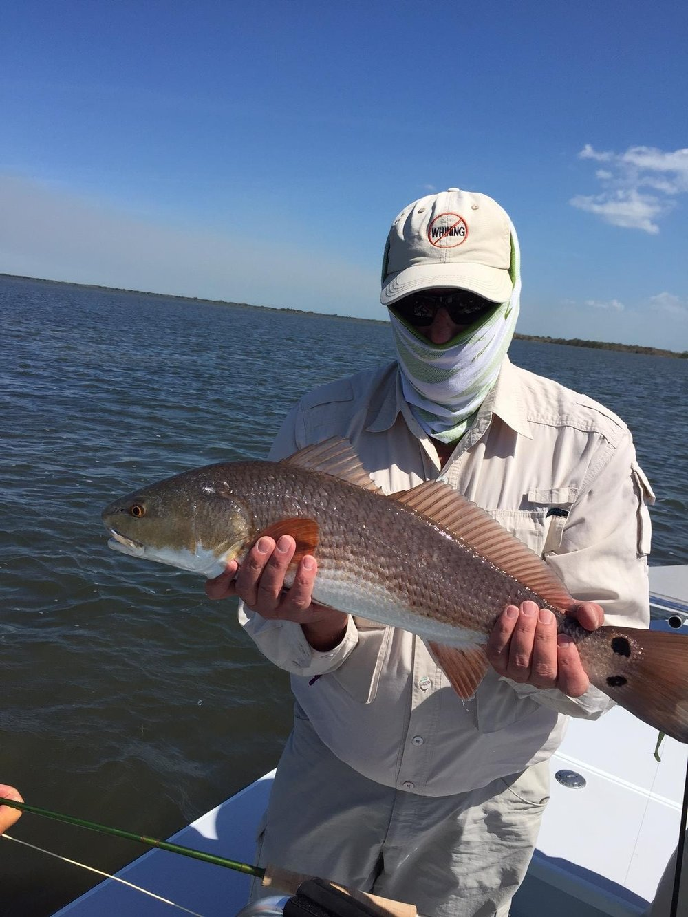 Bruce Salzburg with a redfish in Mosquito Lagoon near Titusville, Florida. Photo by Max Salzburg of Sonja K Photography.
