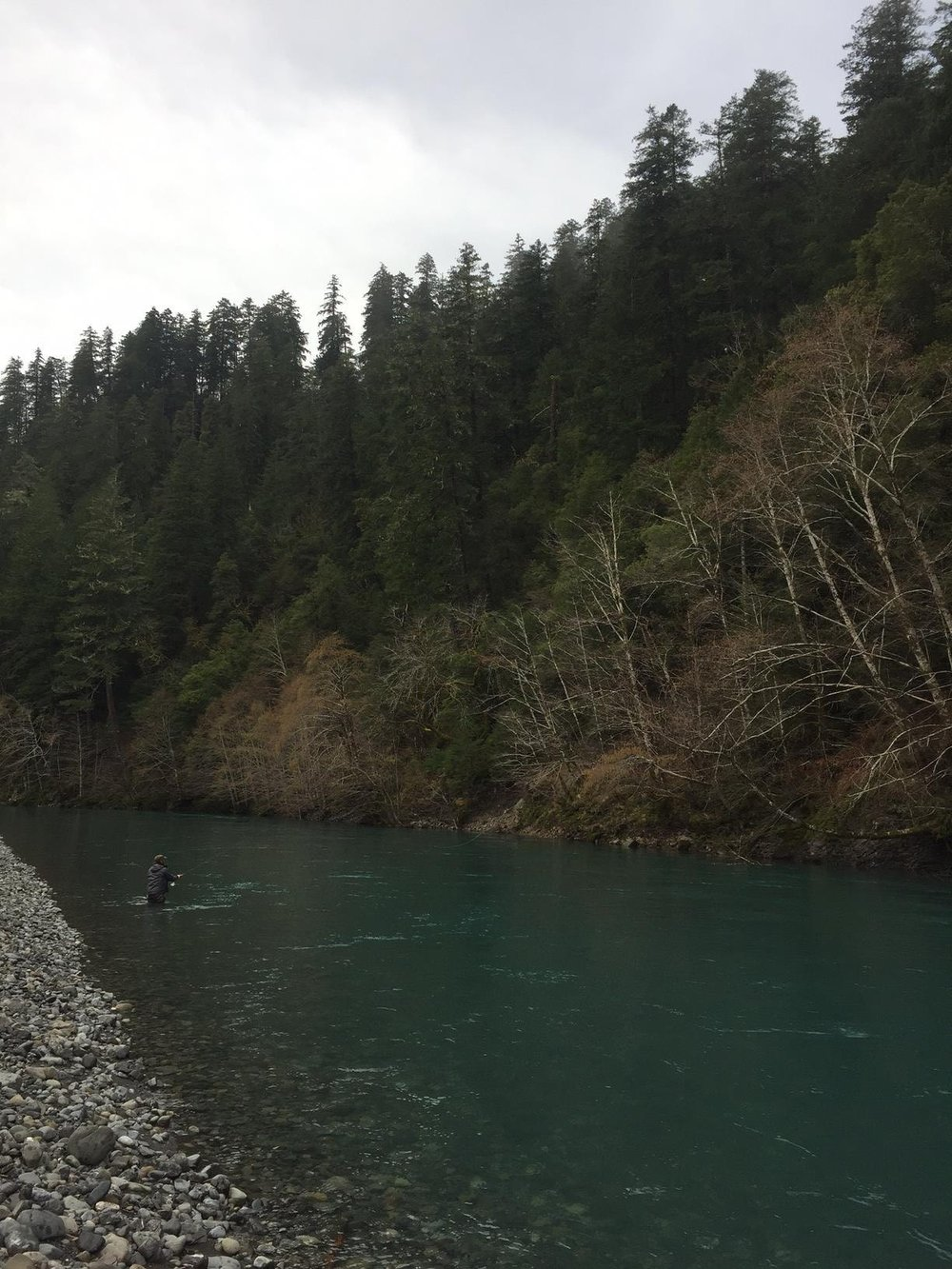 Charles gets some work done on the Chetco River. Photography by Max Salzburg of Sonja K Photography.