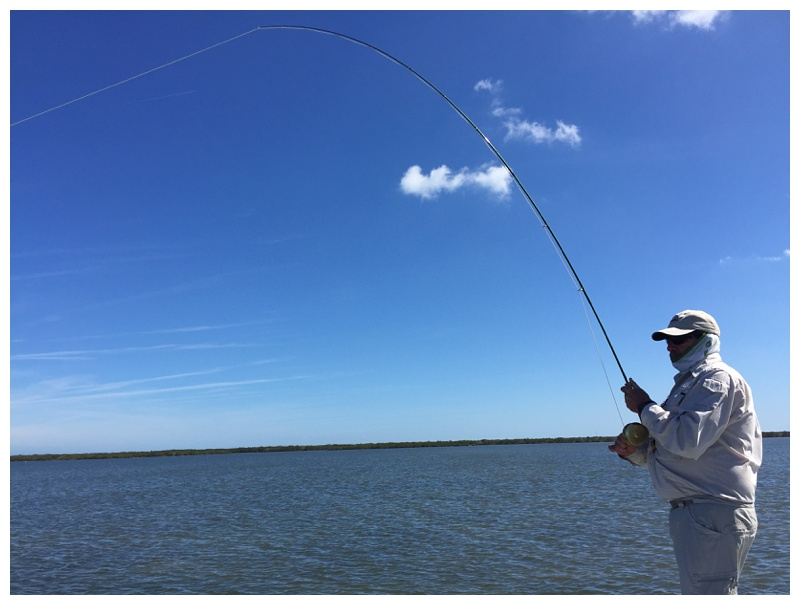 Bruce Salzburg hooked up with a redfish in Mosquito Lagoon near Titusville, Florida. Photography by Max Salzburg of Sonja K Photography.