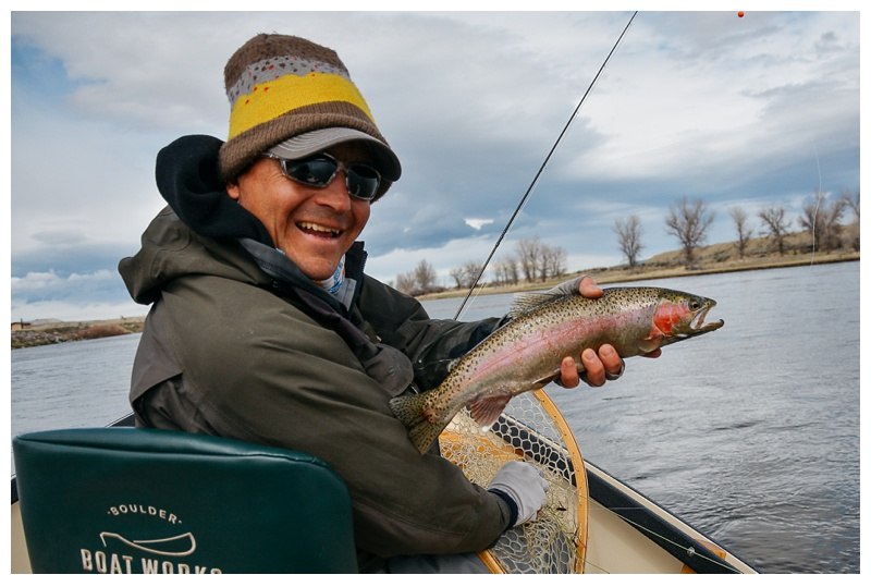 Jason Slotter with a nice rainbow trout on the Grey Reef near Alcova, Wyoming. Outdoor fishing photography by Max Salzburg of Sonja K Photography.
