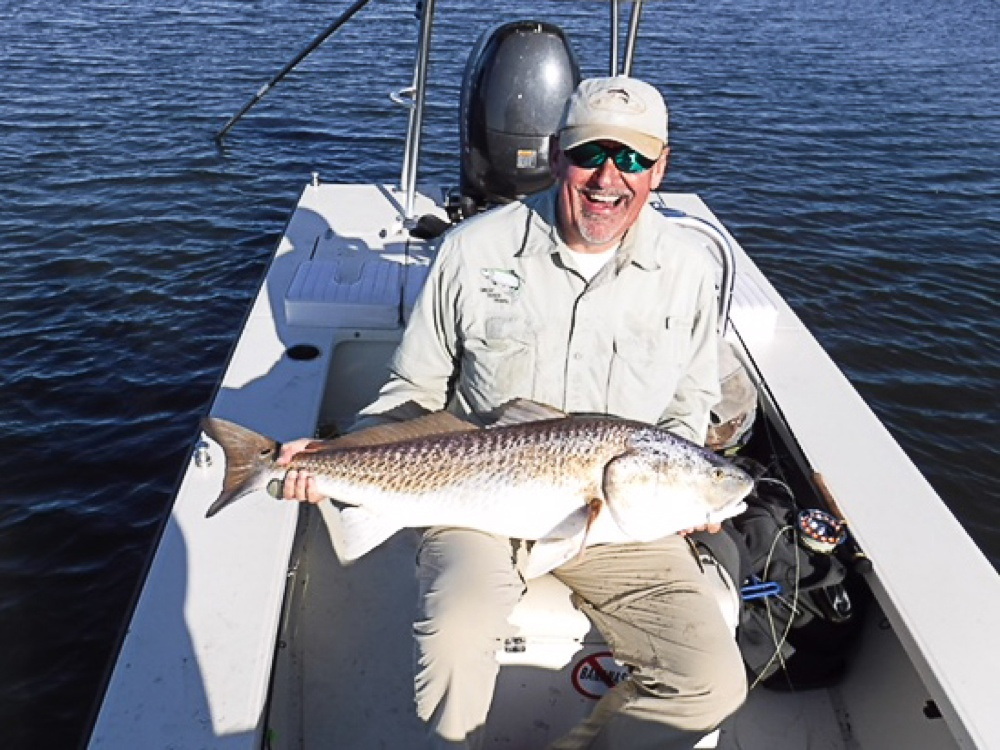 A large redfish caught on fly outside of Port Sulphur, Louisiana.