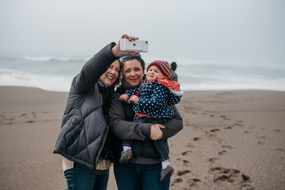 Three generations of women at South Beach Point Reyes National Seashore in California. Family portrait photography by Sonja Salzburg of Sonja K Photography.