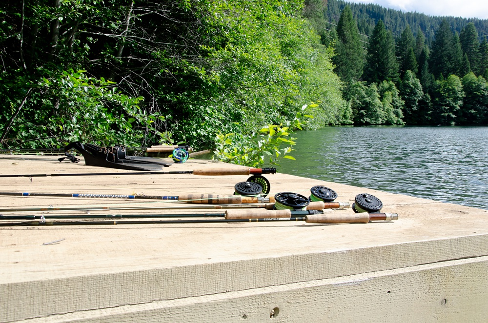 The dock at Clear Lake with fly rods littering it. Fly fishing destination photography by Max Salzburg of Sonja K Photography.
