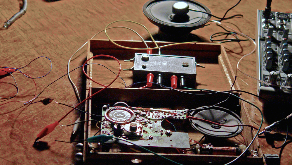 Modified AM Radio,  2009, scavenged radio, speaker, cables, test probes, photocells and plastic.