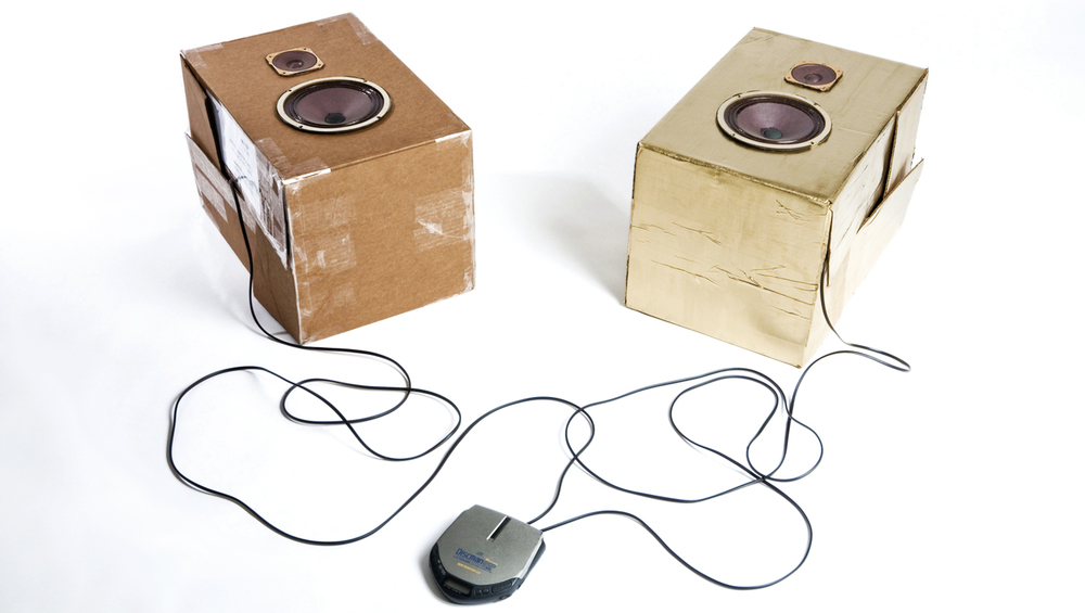 Gold & Noise,    2008,Rich Gold oil paint on used cardboard boxes, speakers, cables, 2 audio channel CD and CD player,  41 x 140 x 115  cm approx.
