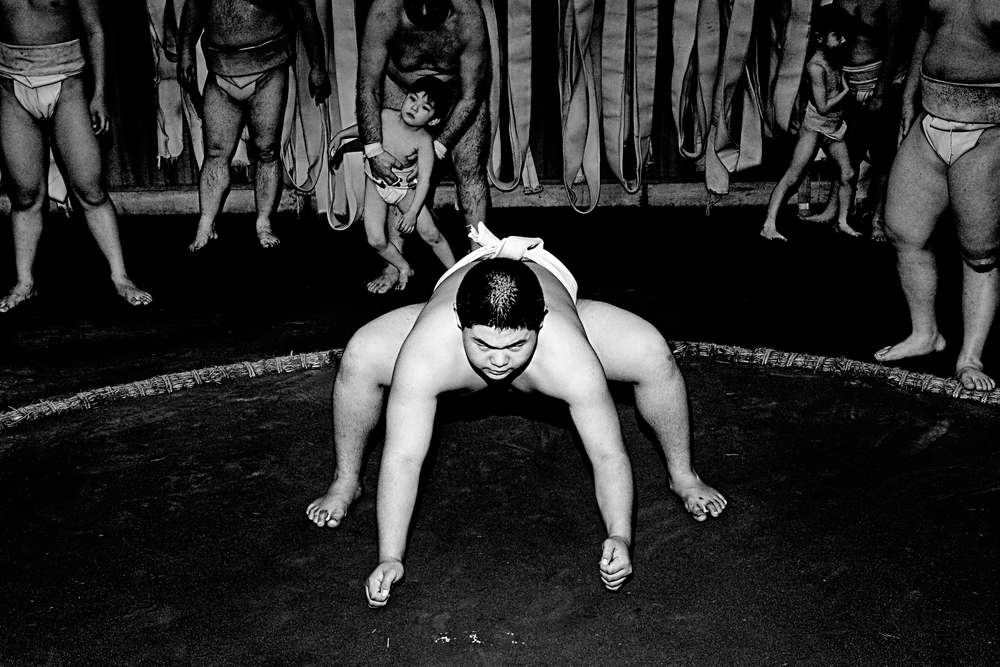 The students play games before and after practice, however once the Oykata - master - enters the room   everyone focuses in an instant. Yoshihiro, 12 years old. Hiragaya Sumo Club in Hakusan, Tokyo.