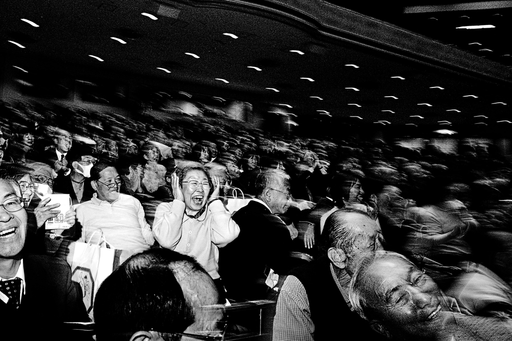 The short fights keep the audience at their feet. A crowd of 13,000 fans in Ryogoku Kokugikan stadium, Tokyo