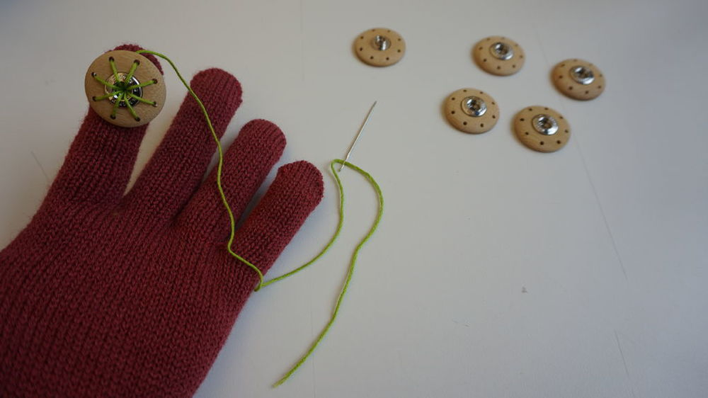 Step 2: Sewing buttons on each finger.