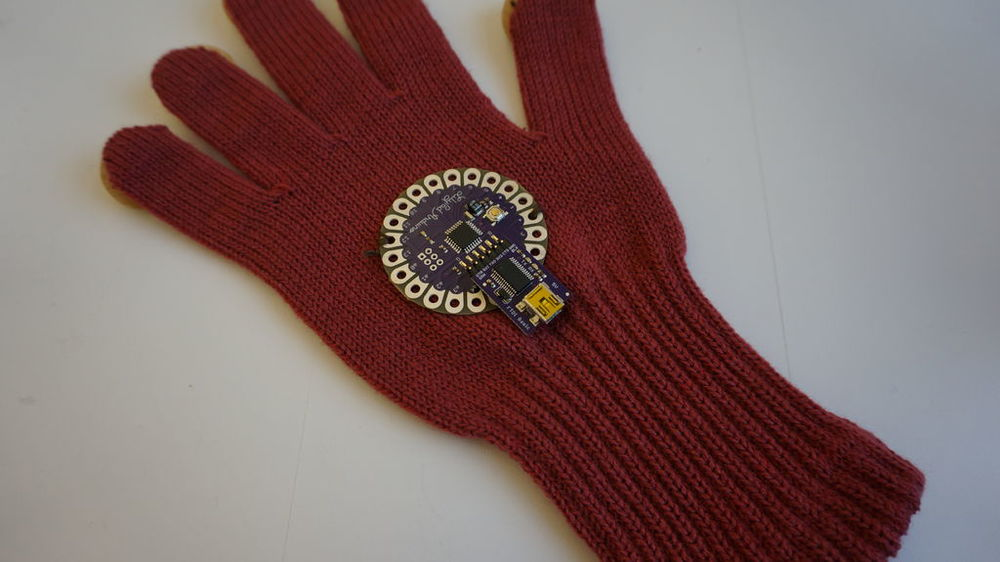 Step 3: Sewing a LilyPad with a normal thread for attaching on the glove.
