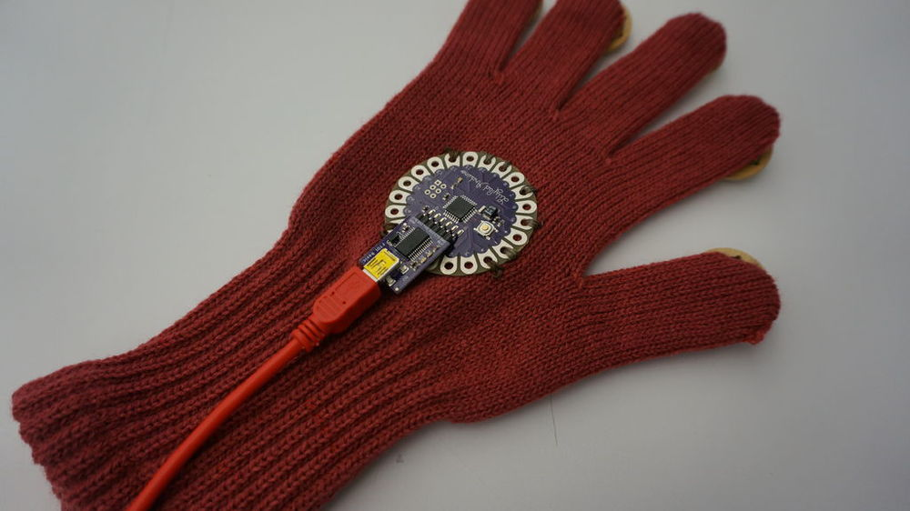 Step 4: ewing conductive threads on each finger to the LilyPad.