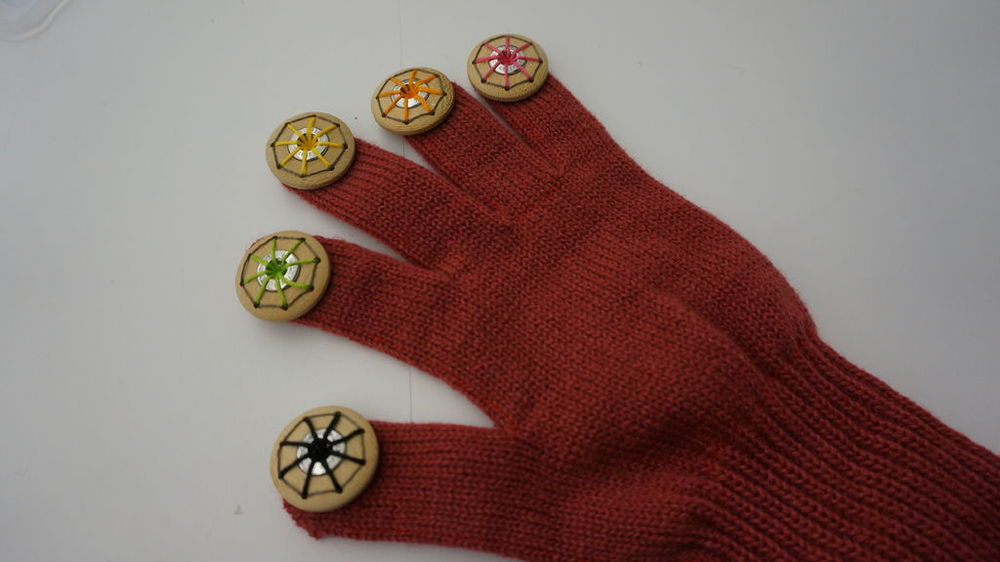 In this project, I focused on an aesthetic design. So, I sewed conductive threads to invisible ways. Normally, when people make a kind of LilyPad gloves, they sew outer surface. I spent a lot of time in this section.