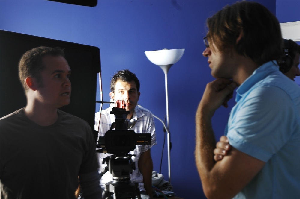 Cinematographer, Alex Dacev watches on as Anthony Greene and Ken Simpson confer.