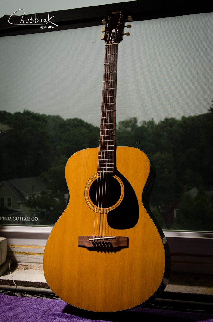 1972 Yamaha FG-110 :: restring.  I have reset the neck on one of these 110's before and it turned out to be one of those great sounding guitars that sticks in my memory.  This one unfortunately is similar in that it needs a neck reset to greatly improve the playability.