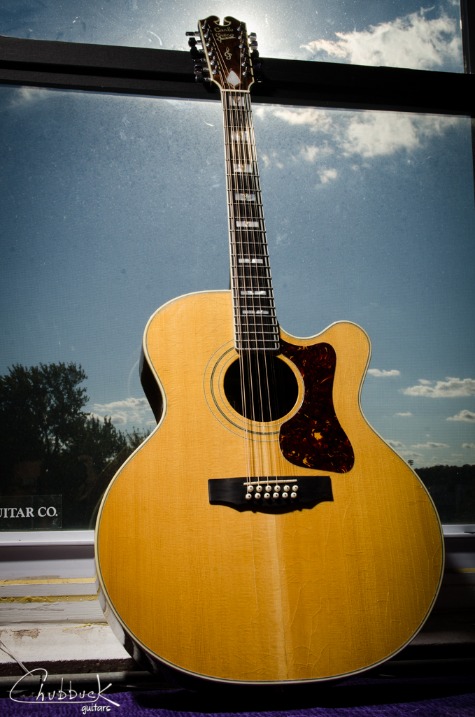 "1992 Carlo Greco 18"" 12 string cutaway :: top center seam splint, bridge re-glue, various top crack repairs and setup."