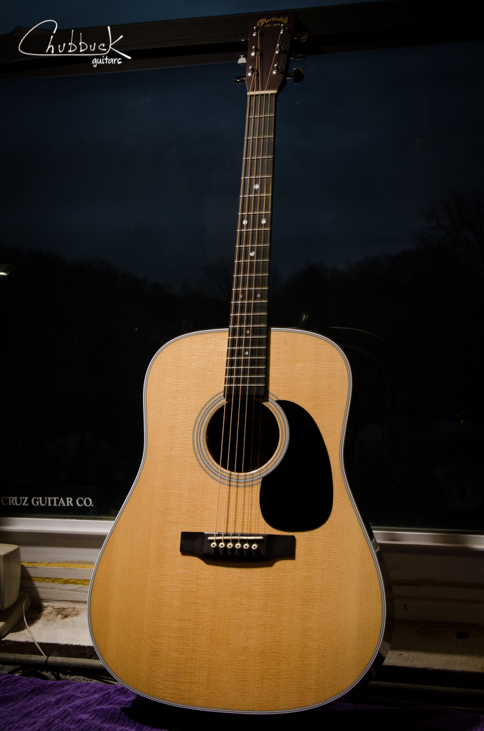 2013 Martin D-28 :: fingerboard crack in the extension repaired and fret ends dressed.