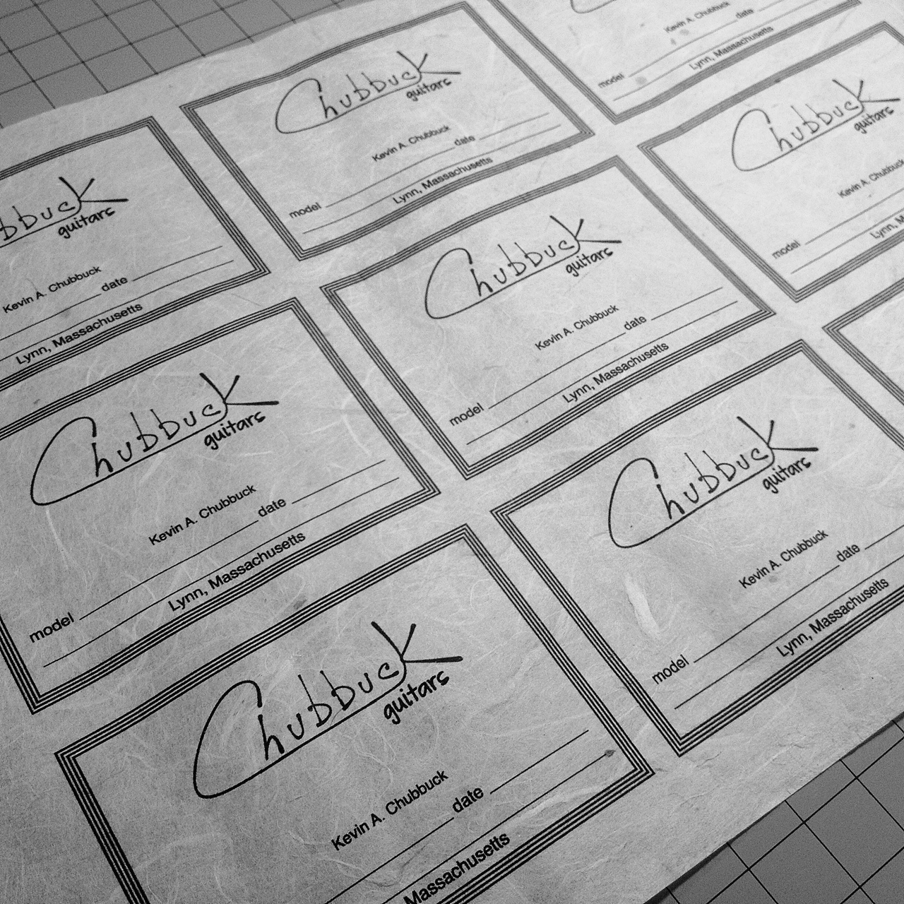 Chubbuck Guitars :: Labels fresh off of the printer. Eventually I want to try screen printing these.