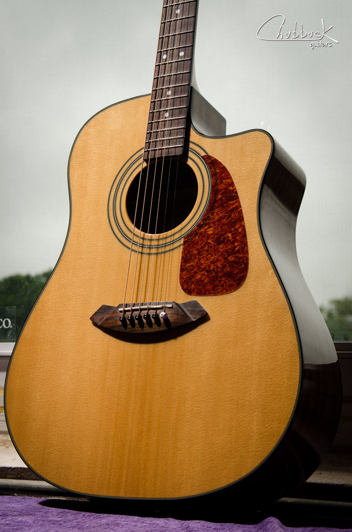 Fender CD-140SCE NAT :: loose x-brace and set up. The rear leg of the treble side x-brace was loose from the bridge to the side.  Glue was applied and the brace clamped through the soundhole.  The saddle was also shimmed up and the guitar tuned a half step down.