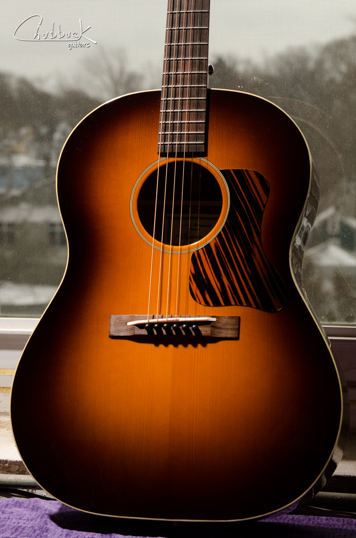 2010 Daniel Roberts Troubadour prototype :: light fret dress over the fingerboard extension. Flame mahogany back and sides, red spruce top and look at that sunburst!