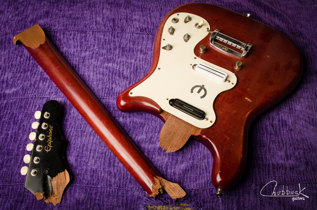 1965 Epiphone Olympic :: headstock and heel break.  This player was at a jam session where he backed up and tripped over some gear.  On the way down he caught his head on a counter top and was knocked out cold just before he and the guitar hit the ground.  Ouch!  The next few nights will be spent fitting loose pieces and gluing the neck back together.  Once glued up, I'll address some missing pieces and prep for finish repairs.  Nastiest neck break to come across my bench so far!