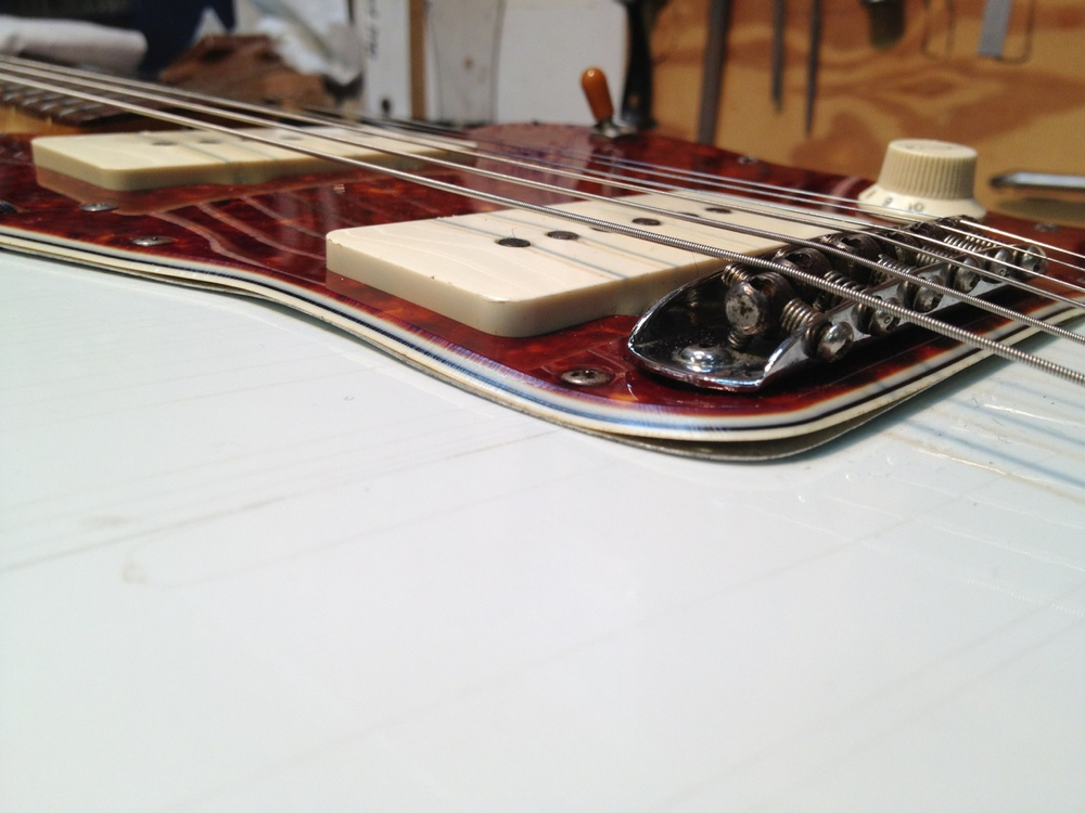 Warped and shrunken pick guard