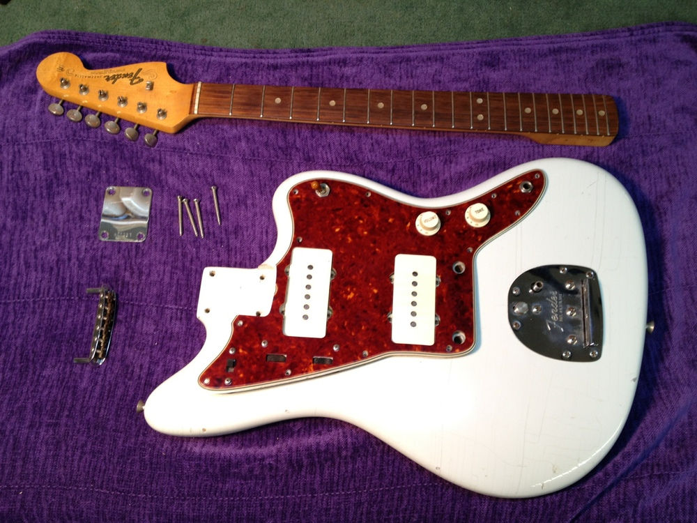Neck and bridge removed and pick guard ready to taken off