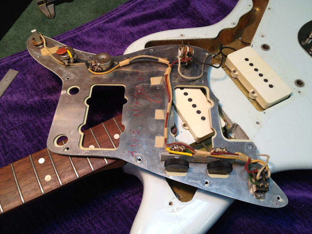 Underside of the pick guard and shield
