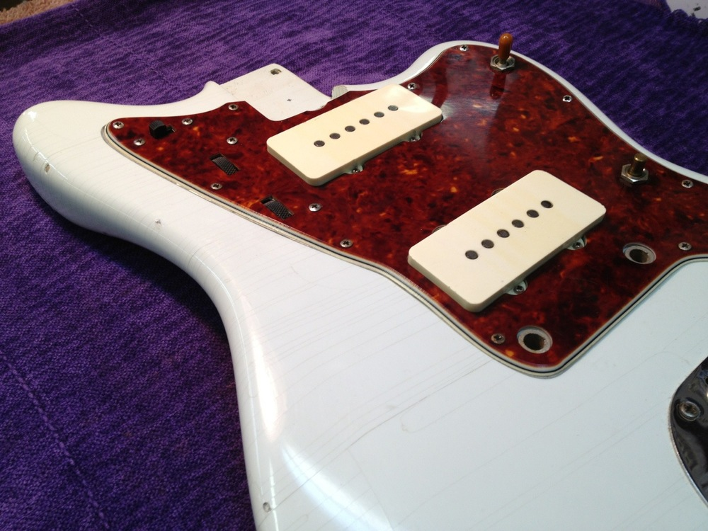 Pick guard remounted after flattening and fitting