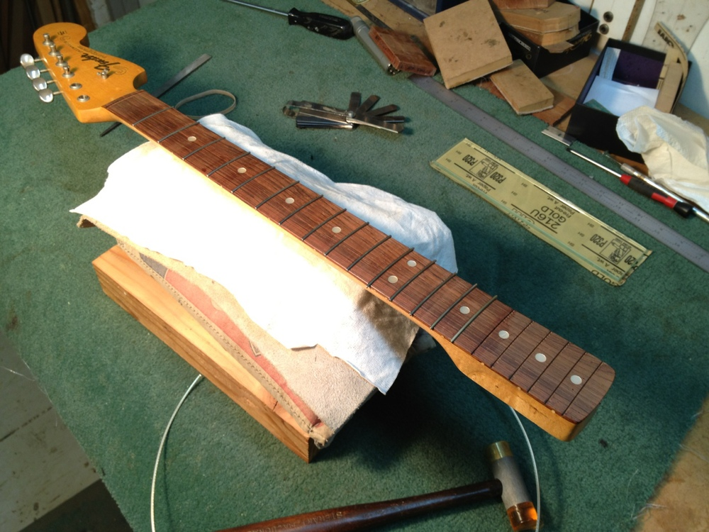 New frets being hammered in place