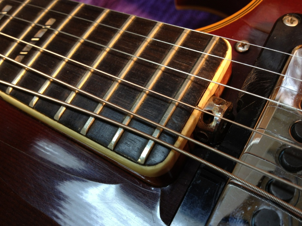 Spoke-nut truss rod adjustment.