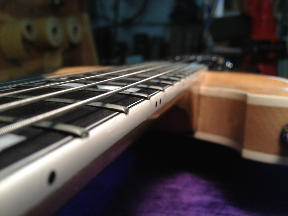 Lifted fret ends making for uncomfortable playing
