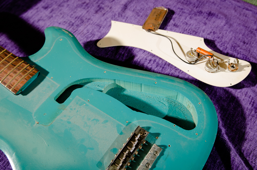 Pickguard assembly is removed.
