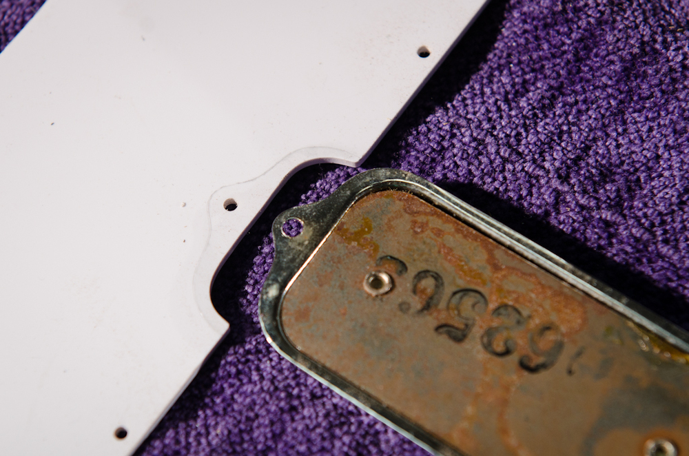 The original pickguard sat on top of the pickup mounting flange and did not allow the pickguard to sit flat against the body. Here is the layout of the material to remove in the guard to allow it to accommodate the flange.