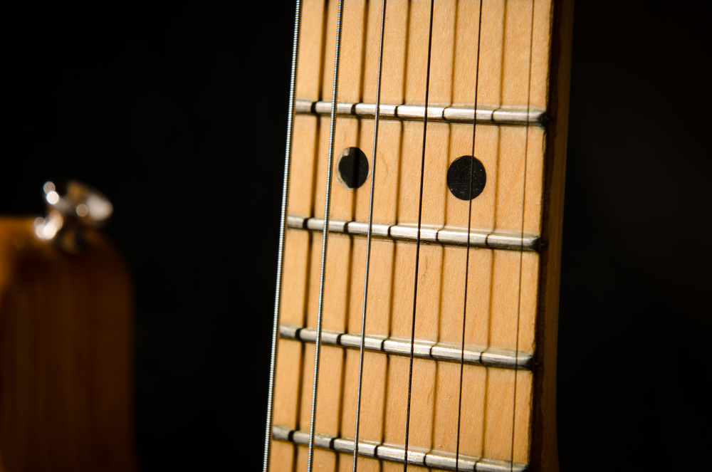 Note the infamous 70's heavy polyester finish on the fingerboard and how it seals in the frets.