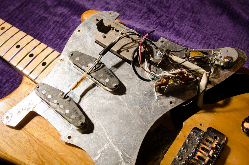 Here is a closer view of the pickguard components and humbucker.