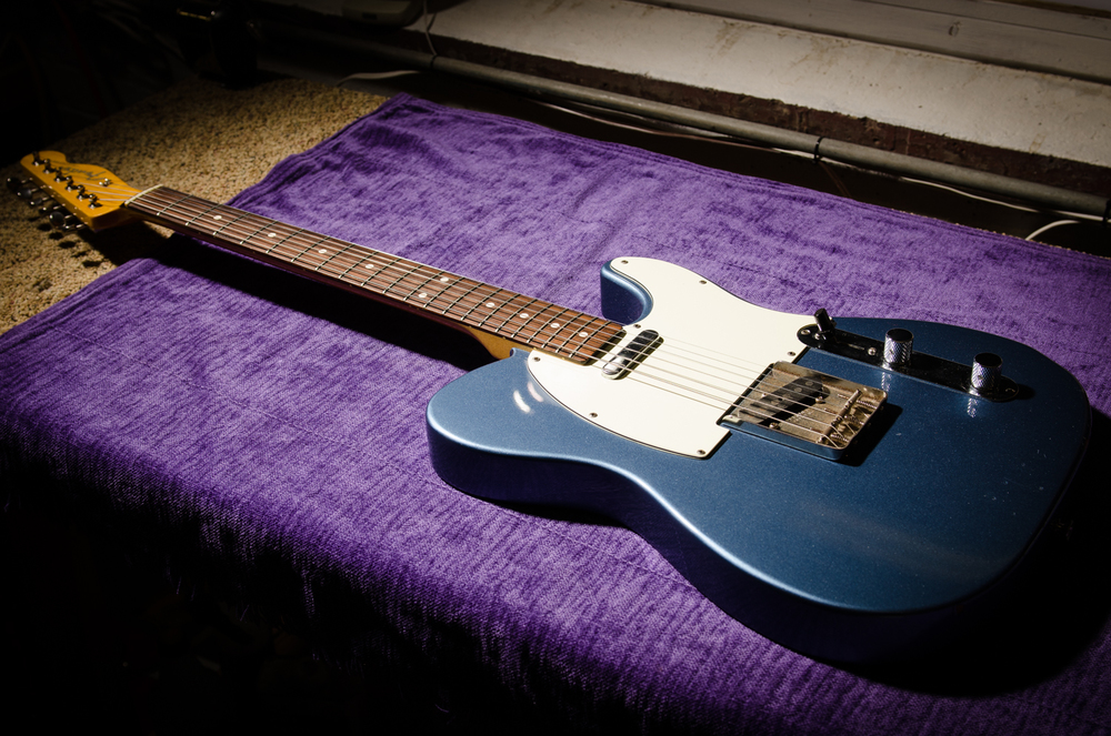 Rather unique metallic blue finish on the body, with a maple neck and rosewood board.