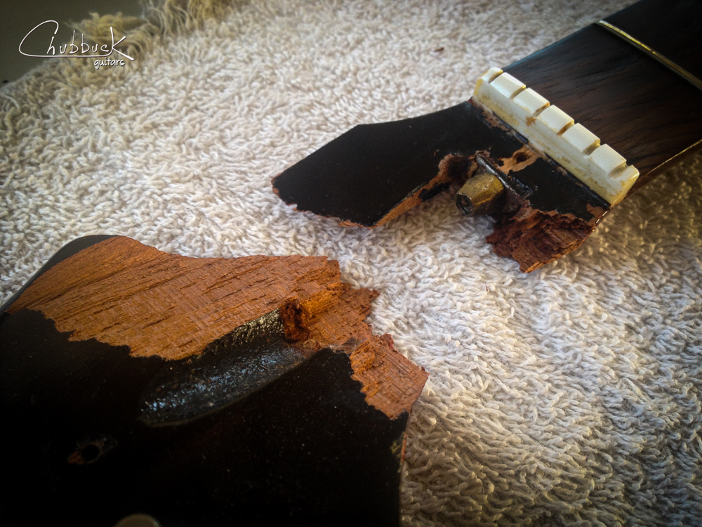Now that the body and neck are glued up, time to move onto the headstock. Here you can see how nasty this break is.