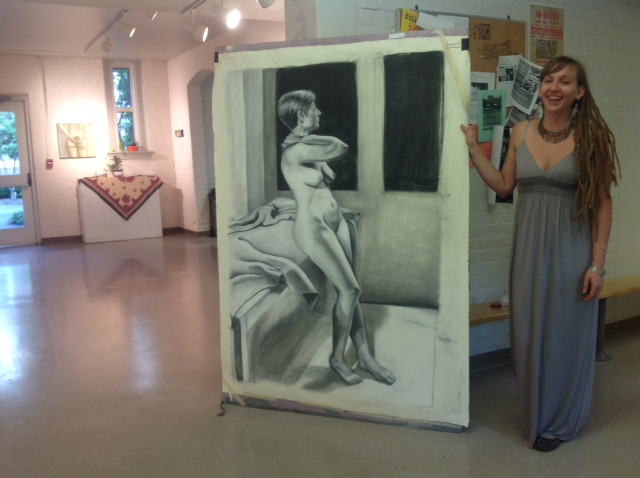 Me with a large scale charcoal drawing at my Thesis reception