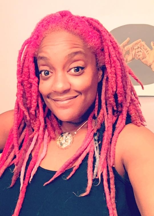pink dreadlocks on an artist