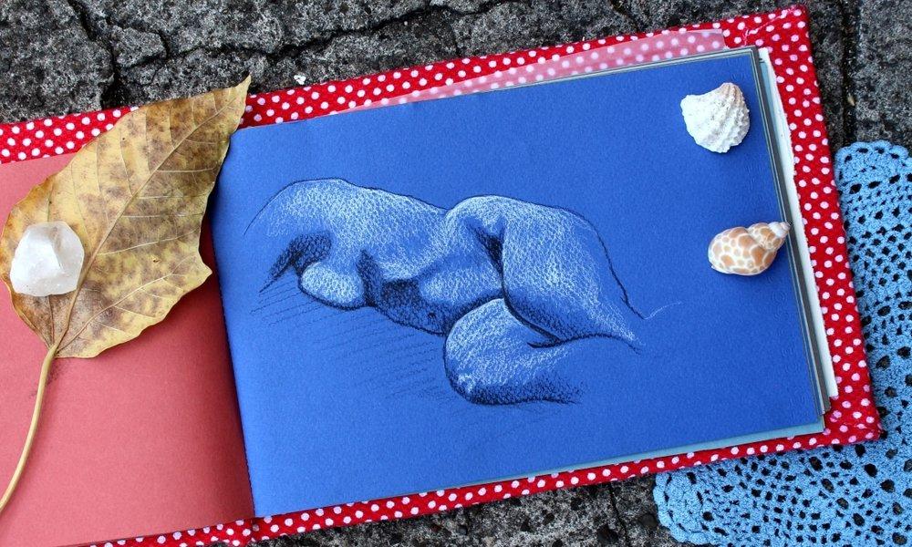 sketchbook of a nude figure drawing in blue