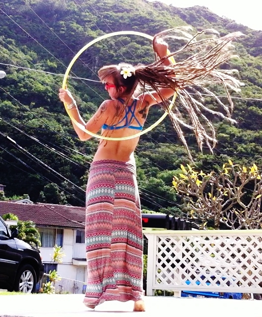 hula hooping girl with dreads