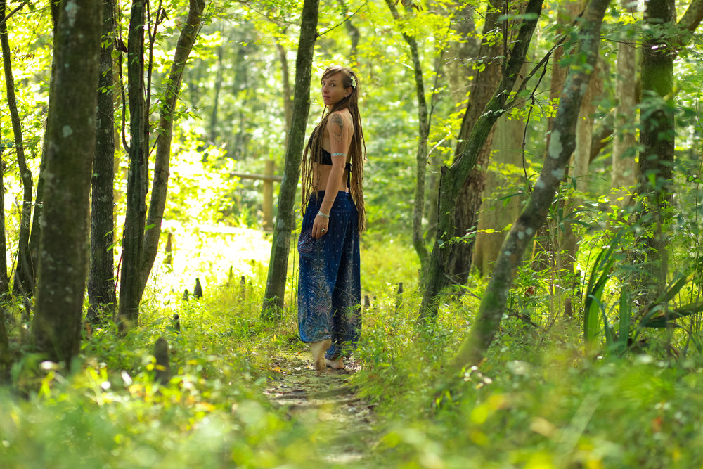 dreadlock model in the woods