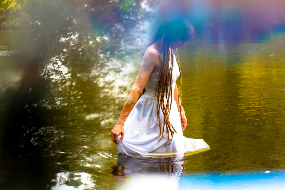 dreadlock muse in the woods