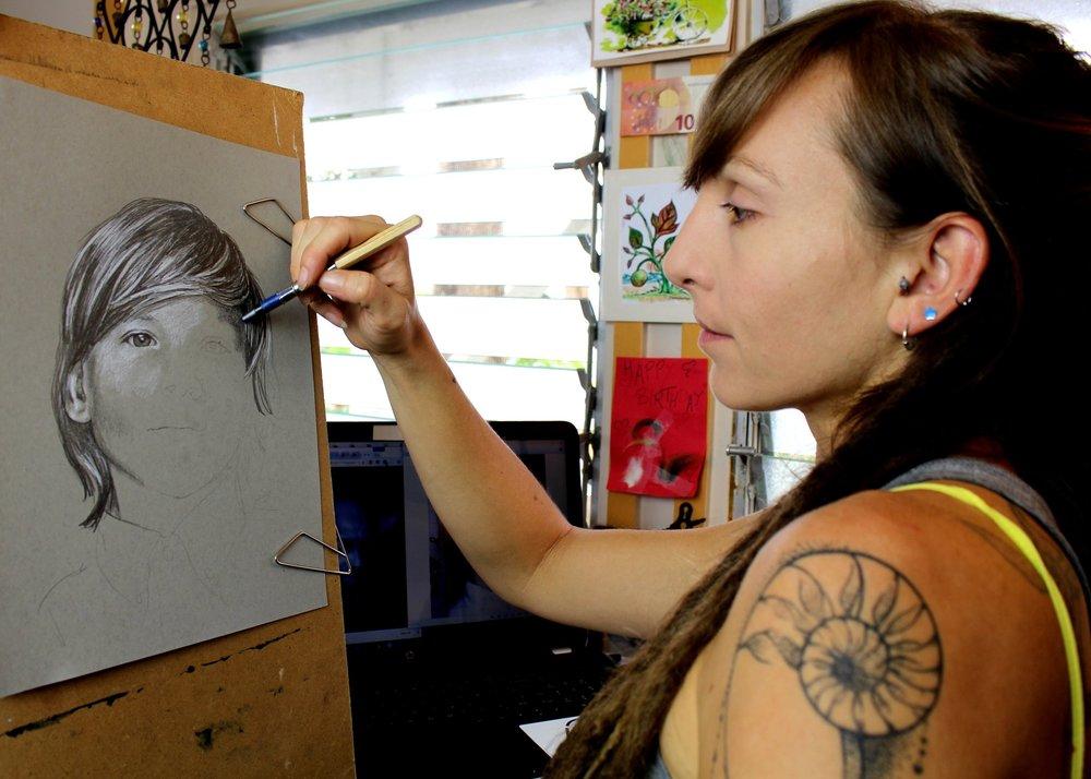 pencil portrait artist in her studio