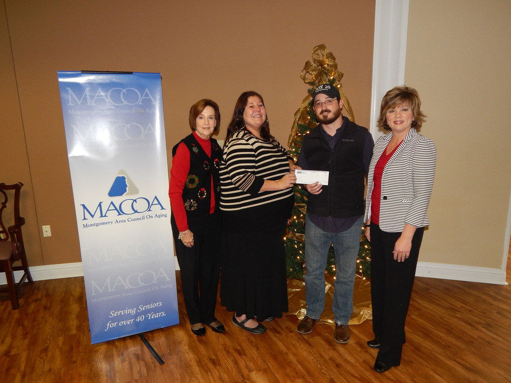 Paul McTear of WCOV Fox 20 with MACOA Staff members, Phyllis Fenn-Development Director, Lila Frazer- Meals On Wheels Assistant, and Cheryl Hidle- Archibald Center Director to receive donation