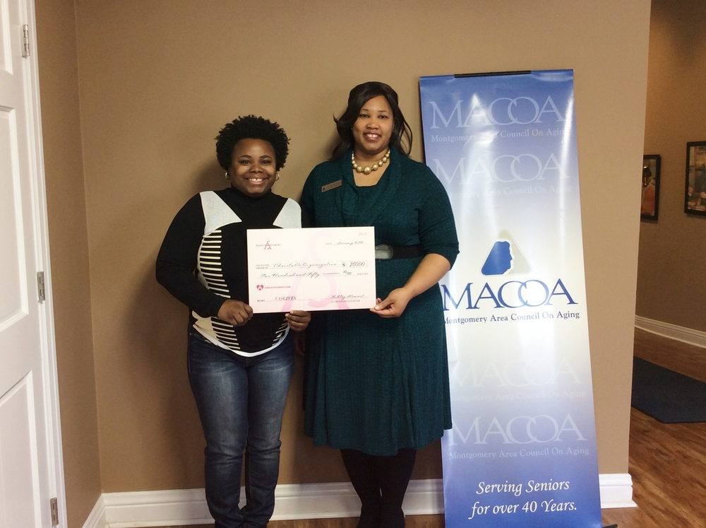 Jennifer Perry- Ashley Stewart Top Sales Associate presents a $250 to Chacolby-Burns-Johnson- MACOA Development Coordinator to benefit MACOA and Meals On Wheels
