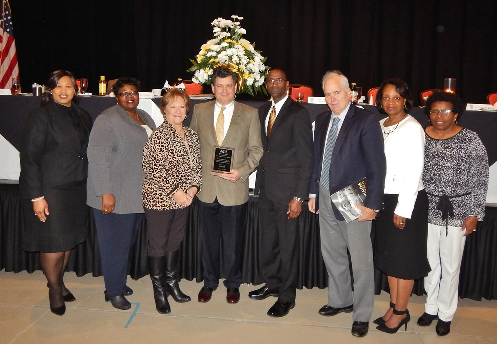 MACOA Board Members and Staff with Lee Jenkins, III- President of the Alpha Upsilon Lambda Chapter of Alpha Phi Alpha Fraternity, Inc. at Martin Luther King, Jr. Breakfast and Awards Ceremony
