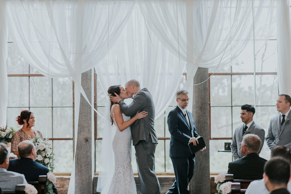 First Kiss Photo|Wedding at Big Sky Barn|Houston Wedding Planners