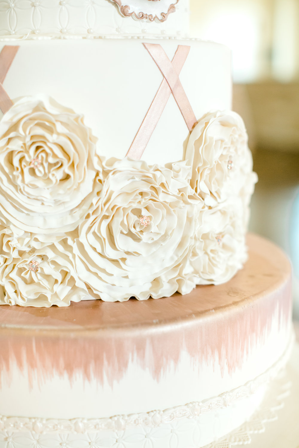 Wedding cake with fondant flowers | Pink and ivory cake in Houston