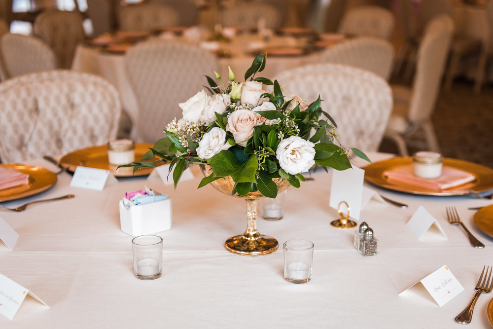 white and pink compote centerpiece with gold accents