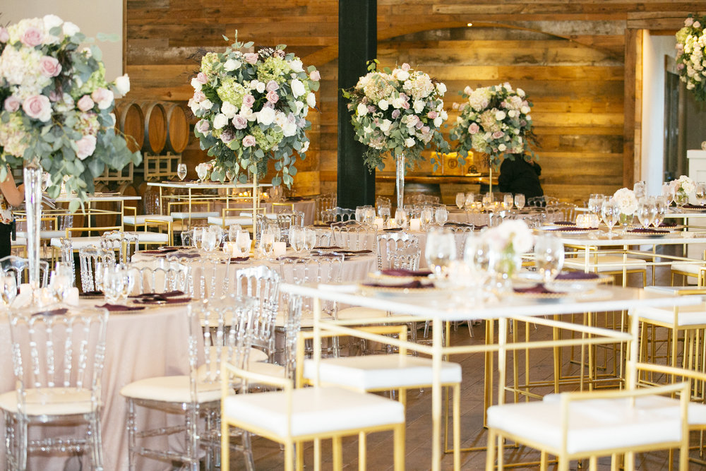 Mauve and blush wedding at the vine, bistro tables in marble and gold, with acrylic chairs